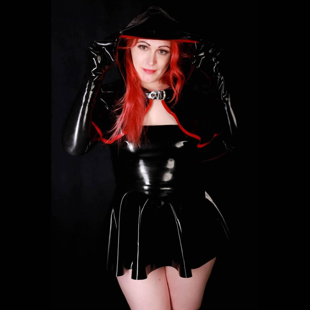 Latex Nikki wearing black latex dress and hood