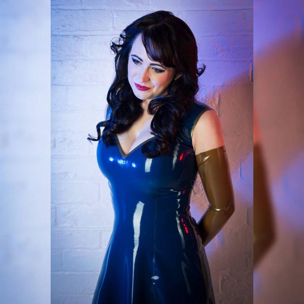 Latex Nikki wearing a blue TLC Latex dress